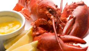 cooked lobster with butter and lemon wedges