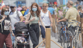 People wear face masks as they walk in the Old Port of Montreal, Sunday, July 4, 2021, as the COVID-19 pandemic continues in Canada and around the world. THE CANADIAN PRESS/Graham Hughe