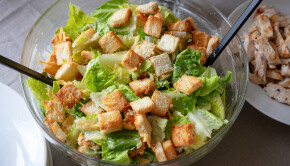bowl of homemade cesar salad with grilled chicken